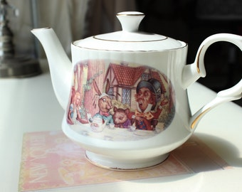 SOLD adorable Alice in Wonderland Teapot, Mad Hatter, 2 cup teapot