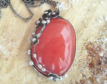 metal  pendant with strawberry quartz cabochon