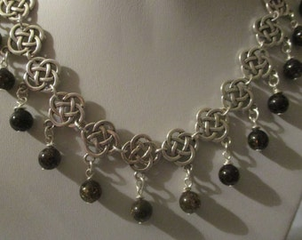 Celtic collar style necklace with smokey quartz