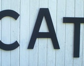 Wooden letters word, CAT, 20 inch black cut in the Arial font style Wall art