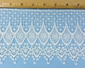 Venise lace, 4.5 inches wide in white
