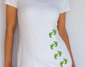 Fun,cute, white  maternity Shirt embellished with footprints Perfect for St Patrick's day or everyday use