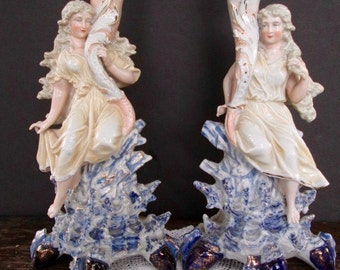 Pair of Porcelain Figural Candlesticks