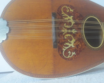 Antique Mandolin Lyon and Healy Bowl Back 8 Strings Includes case.INLAY trim. PRICE REDUCED