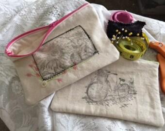 cosmetic bag, pencil bag, zippered bag, purse, clutch