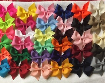 """1.00 bows/10 for10.00/20 for 20.00/30 for 30.00-Pinwheel Bows (U-Pick colors/ list them in """"note to seller"""" at checkout.  Bows (3.5""""-4"""")"""