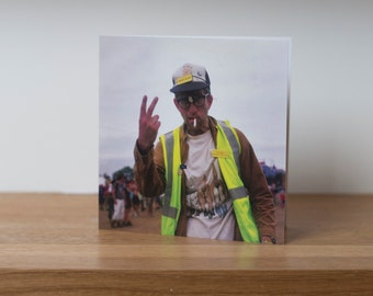 Shite away- a greetings card showing a funny, rubbish collecting, performance artist at Glastonbury Festival
