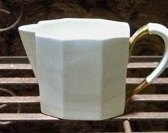 White Ceramic Pitcher With Gold Trim Handle