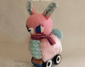 Run Rabbit: Bunny on wheels soft sculpture