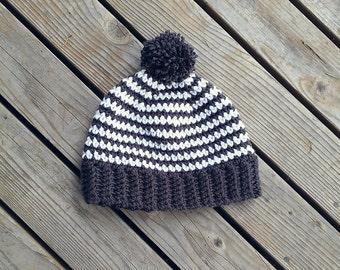 Striped hat with pom pom