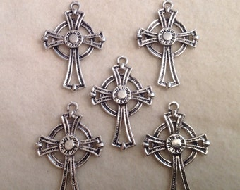 """5 Crosses with """"In God We Trust"""" Inscribed on it"""