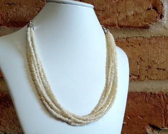 Luster cream colored seed bead multistrand necklace