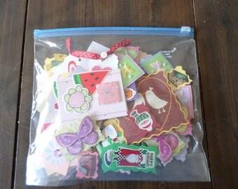 160 assorted handmade paper embellishments