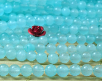 92 pcs of Natural Dyed Blue Jade smooth round beads in 4mm