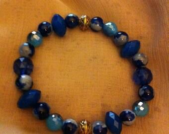 Blue variety bracelet with Celtic knot beads.