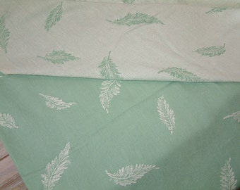 One piece of french vintage mattress ticking in mint green with fern print. Vintage cotton mattress fabric for craft projects. mint green