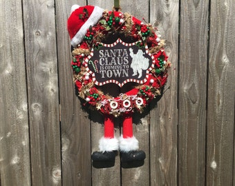 Grapevine Wreaths 2016 Jingle Bell Collection: Santa Clause is Coming to Town with Red and Green Bells, Santa Hat, Legs, and HoHoHo Accent