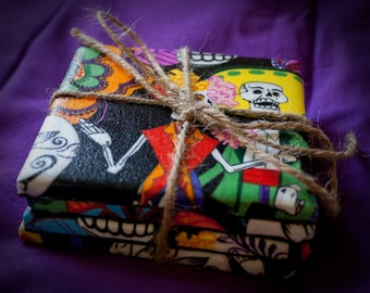 These are hand made day of the dead coasters!