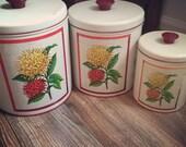 Vintage 3 piece kitchen canister set, fun flower motif.