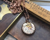 Copper round jeweled watch movement necklace. Handcrafted artistic steampunk jewelry -The Victorian Magpie