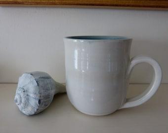 Stoneware mug in white and blue.