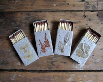 Matchboxes of recycled, handmade paper, encrusted with raw nature material. Set of 4.(no.034)