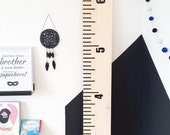 A compact growth chart made of Russian birch, cut by CNC, for a child's room, play room.
