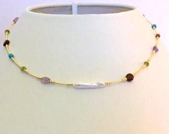 A necklace of semi precious stones and Baroque pearl