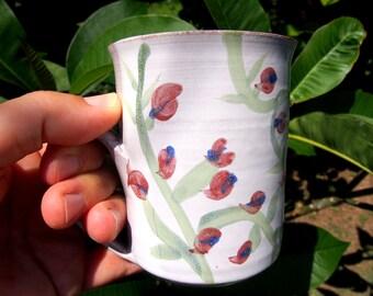 unique coffee mug, scarlet peaflowers, white majolica, glaze