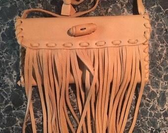 Cross body fringed purse