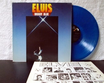 Elvis Presley- Moody Blue. Excellent condition. Original 1977 Blue Translucent vinyl LP 33.
