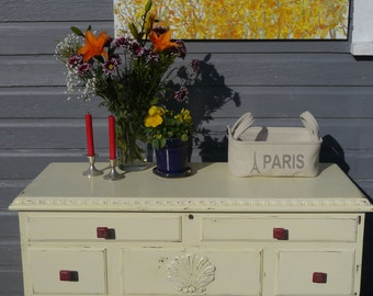 antiqued white trunk with rustic red knobs