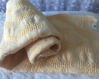 Nap wrap baby blanket.  Strawberry Sam handwoven White & Sunshine Yellow Hearts