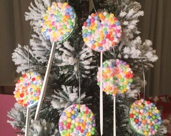 Set of 6 candy land lollipop ornaments.