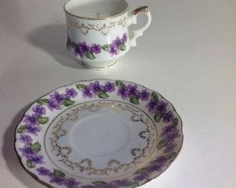 Teacup candle in vintage demitasse cup