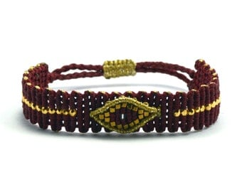 Burgundy bracelet with evil eye