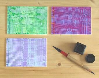 Set van 3 schetsboekjes in Japanse stijl met handgemaakte stijfselmarmer covers. A6 boekjes met Japanse bindingen.
