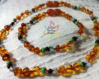 Baltic Healing Amber Baby Necklace and Matching Mommy Bracelet with Green, Black, and Clear Glass Colored Beads and 100% Baltic Amber Beads.