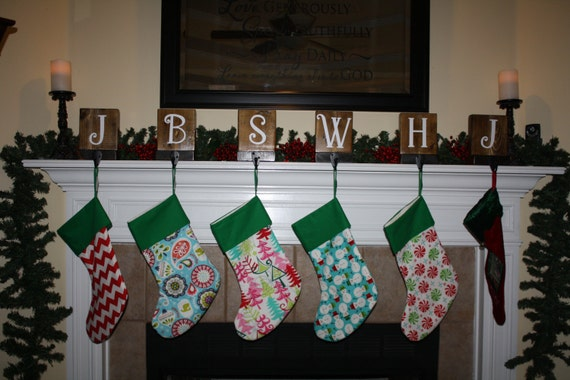 Set of rustic christmas stocking holders for mantle