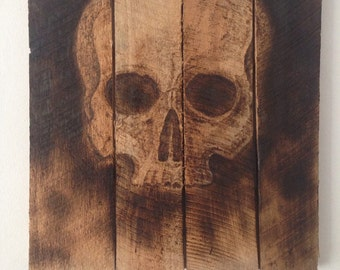 Hand burned panel with skull