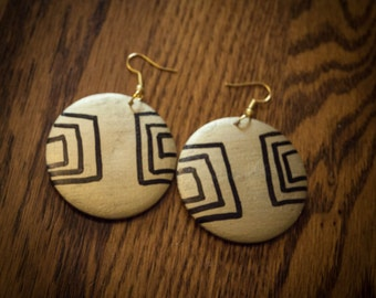 Gold Round Wood Earrings With Black Lines