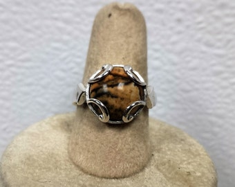 This ring is a size 7 mm picture agate stone.