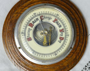 Aneroid Barometer Dark Oak Framed with Enamelled Face and Exposed Mechanism - Circular Wheel Clock Shape Stepped Frame  1930s 1940s Art Deco