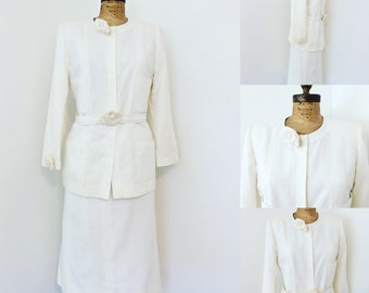 Chanel Skirt Suit! Perforated white cotton, with classic Chanel flower. Stunning!!