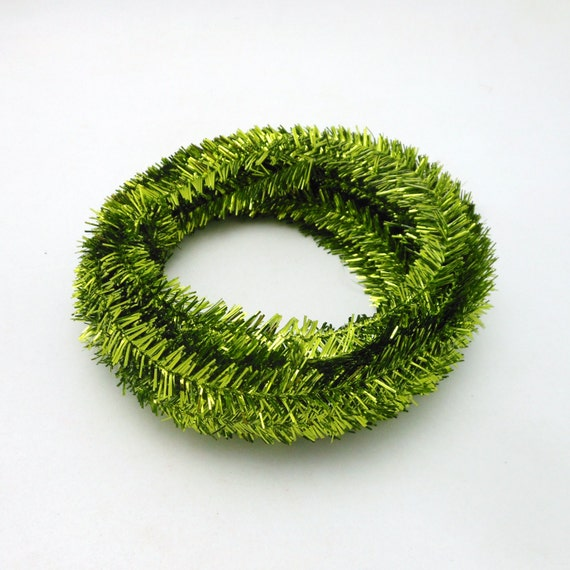 Roll of metallic lime green wired tinsel garland feet