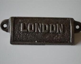 A vintage cast iron London drawer pull LON