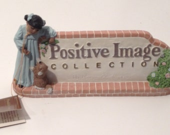 1995 Ceramic positive image collection by Norman A. Hughes Figurine Sign