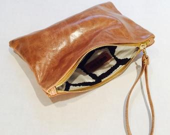 Tan leather clutch