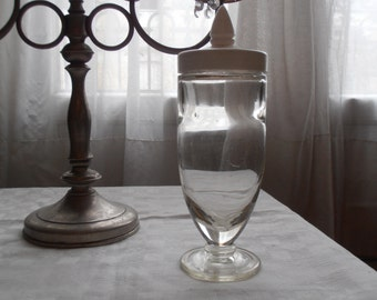 A French vintage glass jar with white plastic pointed lid