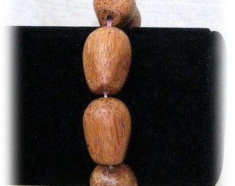WOODEN BEADED BRACELET . . On Stretch Cord . . Never Worn